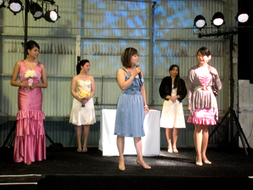Demonstrations were ongoing. Here, Judy Lee of Iridescence Bridal Couture discusses a bridesmaids' dress styling